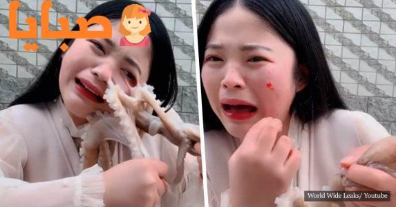 بالفيديو : صينية تحاول أكل أخطبوط حي فتعلق في وجهها وقام بتمزيقة